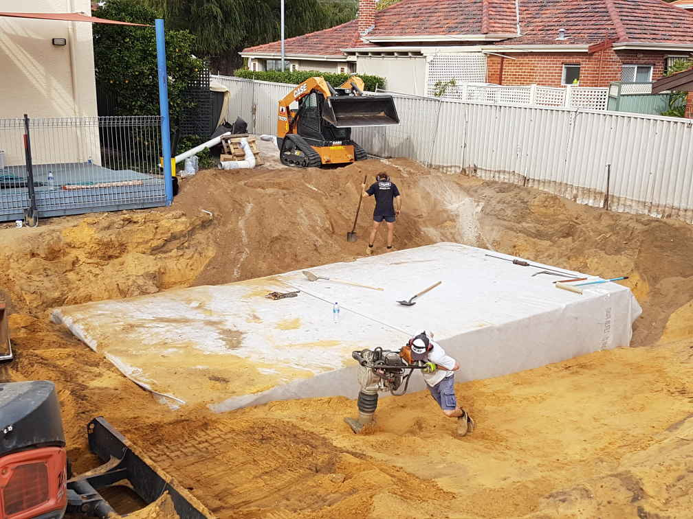 Compacting around large underground water tank